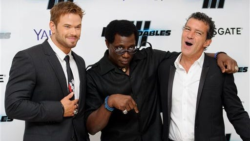 From left, U.S actors Kellan Lutz, Wesley Snipes and Spanish actor Antonio Banderas gesture as they pose for photographers at the World Premiere of The Expendables 3 at a central London cinema, Monday.