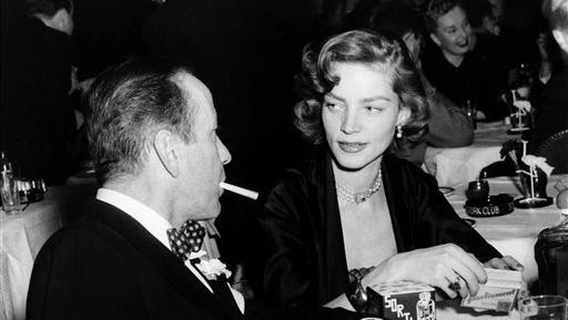 FILE - In this 1950 file photo, actor Humphrey Bogart (left) and his wife, actress Lauren Bacall, appear at the Stork Club in New York. Bacall, the sultry-voiced actress and Humphrey Bogart?s partner off and on the screen, died Tuesday in New York. She was 89.