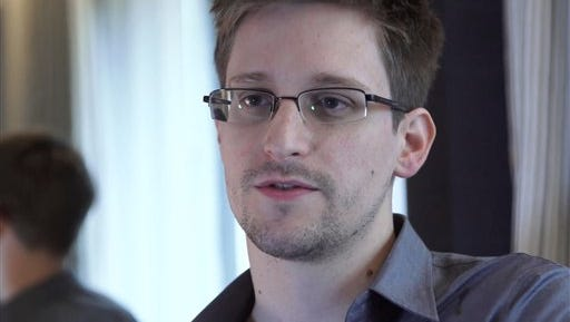 FILE - In this June 9, 2013 file photo provided by The Guardian Newspaper in London shows Edward Snowden, who worked as a contract employee at the National Security Agency, in Hong Kong. Former NSA systems analyst Edward Snowden, who is wanted by the U.S. for leaking details about once-secret surveillance programs, has been granted permission to stay in Russia for three more years, his lawyer said Thursday, Aug. 7, 2014. Snowden last year was granted temporary asylum of one year in Russia, but that ran out on Aug. 1. (AP Photo/The Guardian, Glenn Greenwald and Laura Poitras, File)