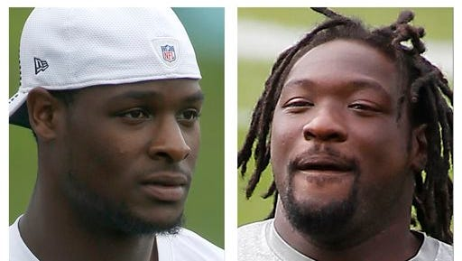 FILE - From left are Pittsburgh Steelers running backs Le'Veon Bell, in a July 30, 2014, file photo, and Steelers' LeGarrette Blount, in a Sept. 10, 2013, file photo, when he was with the New England Patriots. Police have filed marijuana possession charges against Bell and Blount following a traffic stop. Police in the Pittsburgh suburb of Ross Township say a motorcycle officer pulled over Bell?s Chevrolet Camaro when he smelled marijuana coming from it about 1:30 p.m. Wednesday, Aug. 20, 2014. (AP Photo/File)