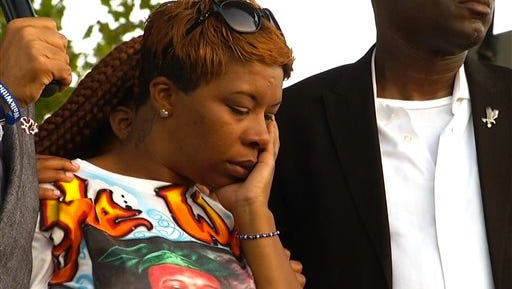 Lesley McSpadden, Michael Brown's mother, appears at Peace Fest, Sunday, Aug. 24, 2014, in St. Louis. Hundreds of people gathered in St. Louis? largest city park Sunday at a festival that promoted peace over violence. (AP Photo/Alex Sanz)
