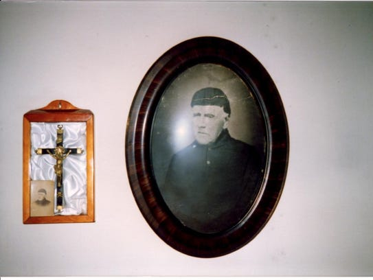 A picture of the Rev. Francis Pierz hangs next to the