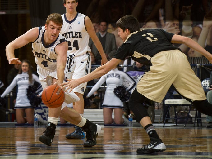 Butler University's Erik Fromm (4) steals the ball away from Manchester University's Blake Brouwer (2) during the first half of an NCAA college basketball game Monday, Dec. 9, 2013, in Indianapolis.