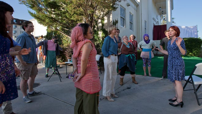 "Director Chase McKenna talks with the cast during rehearsal for ""A Midsummer Night's Dream"" in front of the Lear Theater on Wednesday, June 4, 2014."