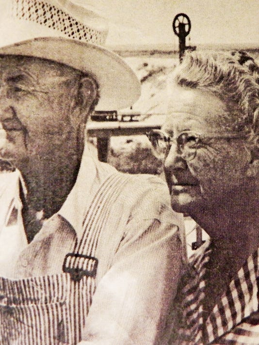 "This photo of William Henry ""Buster"" and Florence Mitchell was taken in 1976 while standing inside the chain-link-fence-enclosed weather station at Avalon Dam. The photo appeared with an article written by Jean Tracy."