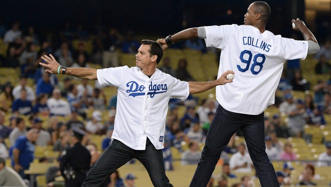 Former NBA player Jason Collins (98) and former Tigers outfielder Billy Bean throw out the ceremonial first pitch before a 2013 game between the Rockies and the Dodgers. Bean played for the Tigers from 1987-89.