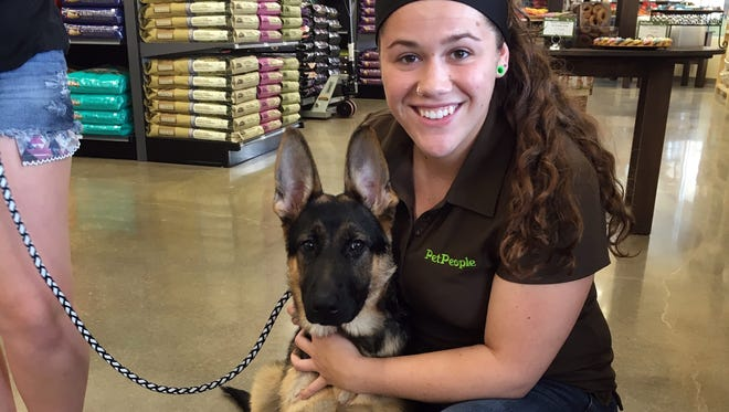 PetPeople store employees always welcome leashed pets, calling it the highlight of their day.