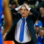 Kentucky head coach John Calipari reacts after a foul in the first half of an NCAA college basketball game against Georgia, Tuesday, March 3, 2015, in Athens, Ga. (AP Photo/John Bazemore)