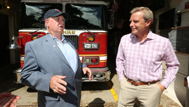 "Welles Crowther's father Jeff of Upper Nyack, left, talks with Tom Rinaldi at the Empire Hook and Ladder Co. #1 in Upper Nyack Aug. 17, 2016. Rinaldi is the author of a book about Welles, ""The Red Bandanna: A life. A choice. A legacy."""