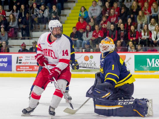 Cornell's Mitch Vanderlaan can't get to a puck over