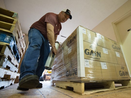 Andy McNelia of Harrington wraps a pallet of meals which will shipped to countries around the world during their day long packaging session at Calvary Wesleyan Church in Harrington. In total they will ship 100,000 meals.