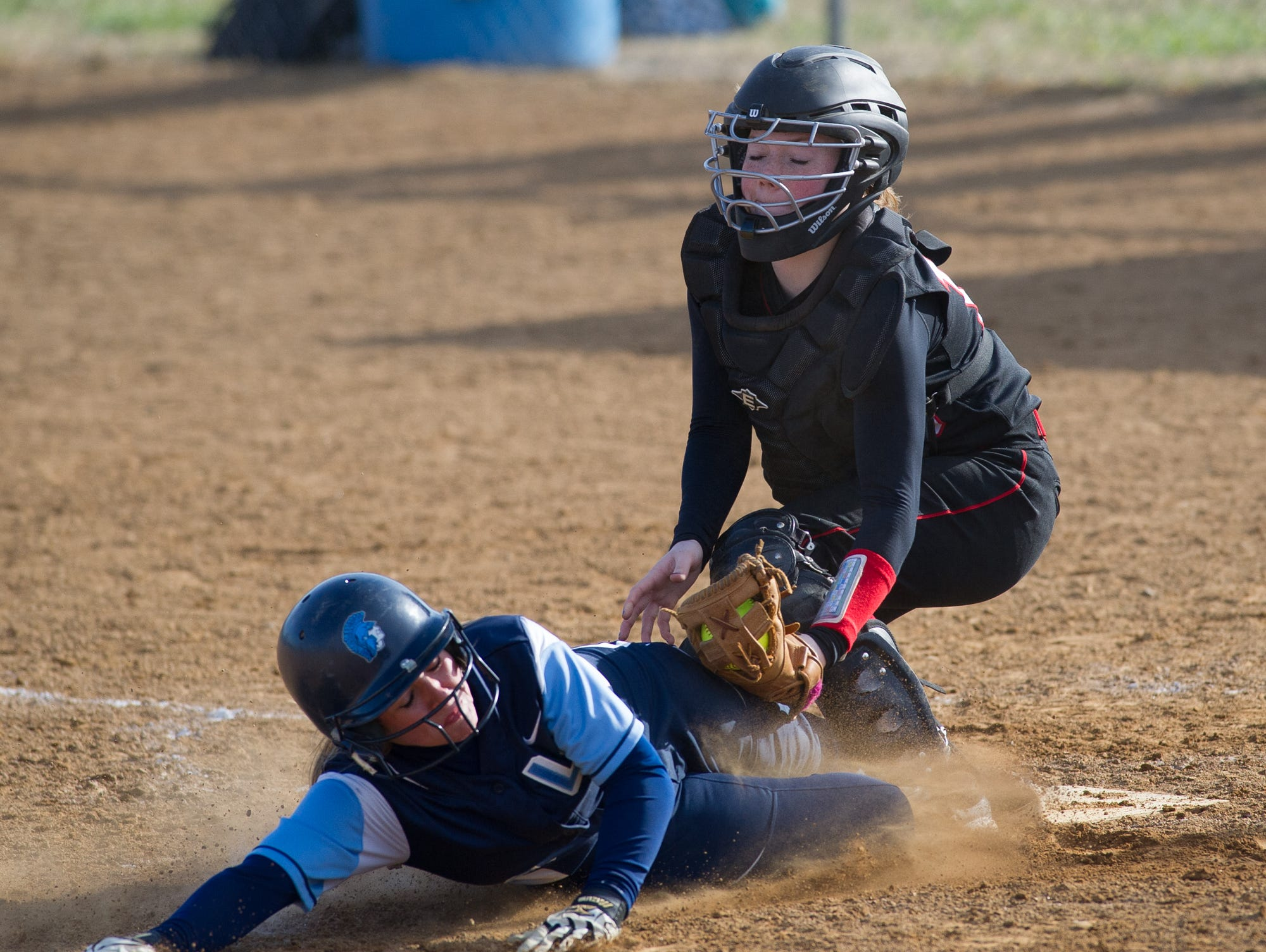 Lake Forest's Brittany Baker (3) is tagged out at home plate by Red Lion's Madelyn Beres (18).