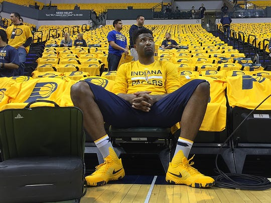 Indiana Pacers forward Solomon Hill  sits waiting to warm up to play the Toronto Raptors in their Eastern Conference first-round playoff game Thursday, April 21, 2016, at Bankers Life Fieldhouse.