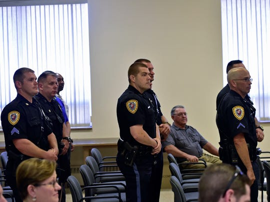 Chambersbrug Policemen show supports by attending the searing ceremony of a new police chief. Chief Roland Camacho was sworn in by town council as Chambersburg's newest Chief of Police on Monday, June 27, 2016.