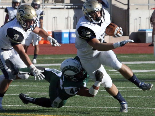 Coronado running back Daniel Stephens, 32, tries getting