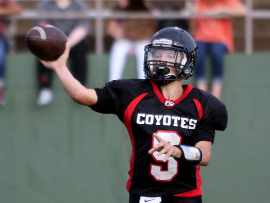 Wichita Falls High School's Jacob Carr passes in the