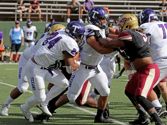 Tarleton State's Xavier Turner runs around the line of scrimmage in the game against Midwestern State Saturday, Nov. 4, 2017, at Memorial Stadium in Wichita Falls. Turner was a one-man wrecking crew against MSU's defense with 145 yards rushing and two TDs; 94 yards receiving with one TD; and also completed a 3-yard TD on a halfback pass. But the Mustangs won 45-42 in overtime.