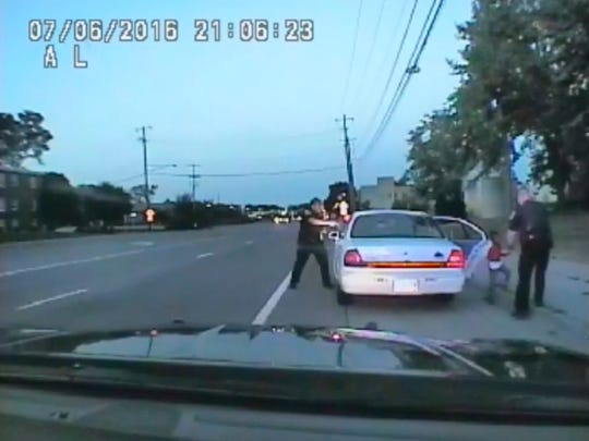 In this image made from July 6, 2016, video captured by a camera in the squad car of St. Anthony Police officer Jeronimo Yanez, the Minnesota police officer is shown after shooting into the vehicle at Philando Castile during a traffic stop.