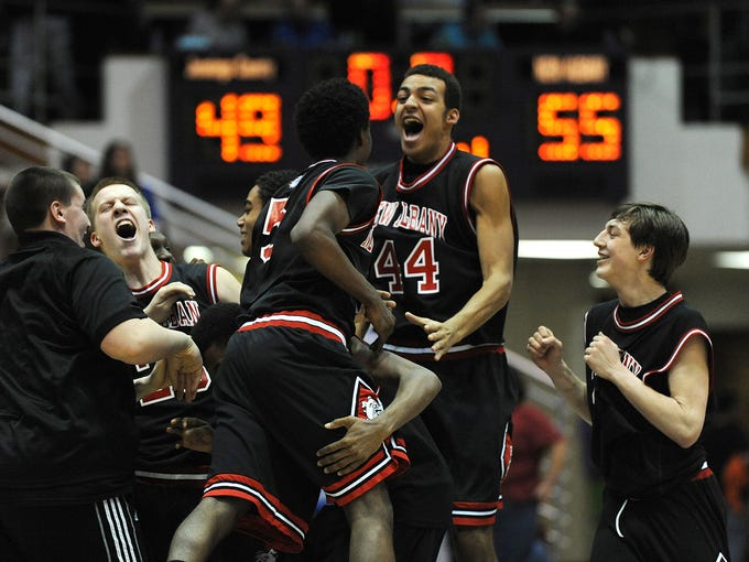 New Albany celebrates after beating Jennings County 55-49 on Saturday during the Boy's Sectional Basketball Tourney at Seymour High School. Mar. 8, 2014