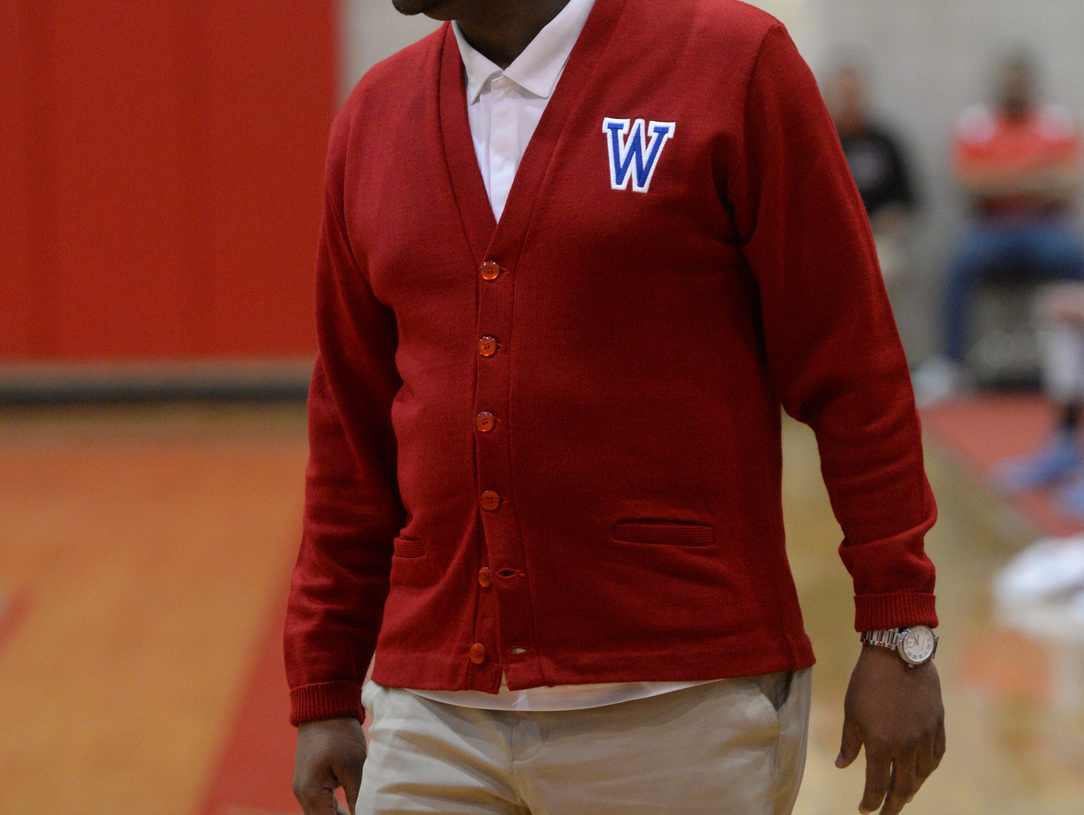 Woodlawn head coach Kenny Sykes passes the bench.