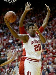 Indiana Hoosiers forward De'Ron Davis (20) drives around Nebraska Cornhuskers center Jordy Tshimanga (32) in the first half of their game Wednesday, Dec. 28, 2016, evening at Assembly Hall in Bloomington IN.