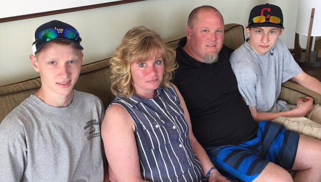 The Latulippe family relaxing in their hotel suite between activities. From left, Brandon Latulippe, Melanie Latulippe, Peter Latulippe and Cameron Latulippe.