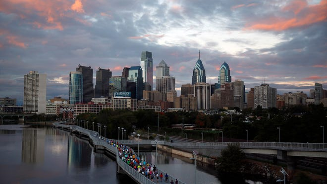 Runners jog along the Schuylkill Banks Boardwalk in Philadelphia in 2014. Democrats are set to begin their convention at the end of July 2016 in a city that symbolizes both the nation's promise and its shortcomings.