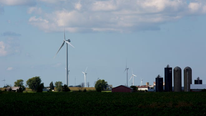 Wind turbines line the landscape Thursday, August 18, 2016 in Marion Township.