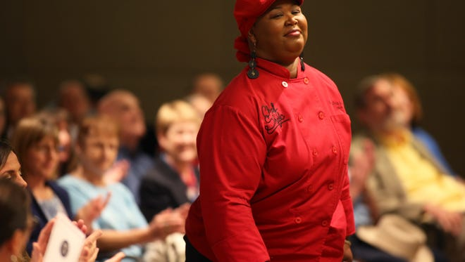 """Tallahassee chef Shacafrica Simmons, known as Chef Shac, stands to accept a key to the city for her local restaurateur work and recent win on the Food Network show """"Chopped"""",during a ceremony at City Hall Wednesday, June 28, 2017."""