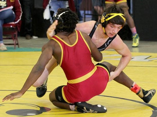 Crescent High School's David Porter wrestles Marion's
