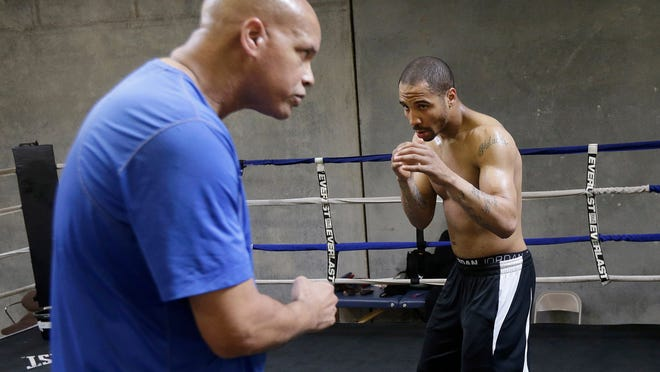 Andre Ward, right, works out with trainer Virgil Hunter last June. (AP Photo/Jeff Chiu)