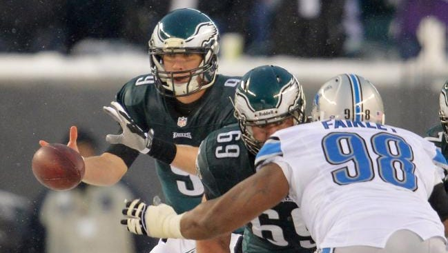 Eagles quarterback Nick Foles takes a snap against the Lions during the fourth quarter Sunday.