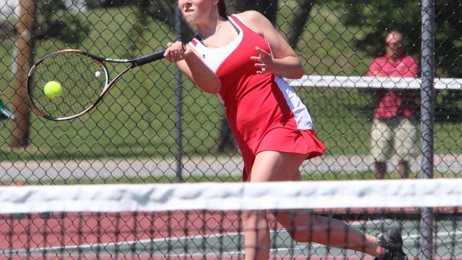 CVU's Mackenzie Buckman crushes a forehand during the Redhawks' 5-2 win over South Burlington in the Division I high school girls tennis championship Thursday.