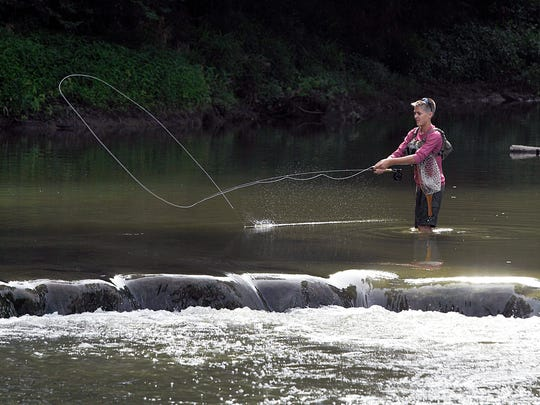 Will Murker fishes in the middle of the Harpeth River near the Eastern Flank river access point on Lewisburg Pike.  In 2012, a low-head dam on Lewisburg Pike was removed. In March 2017, the TWRA released rainbow trout into the Harpeth River.