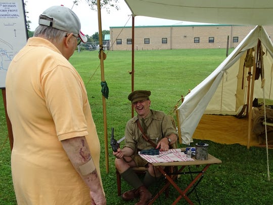 Keith Ryder, of Wheaton, Illinois, laughs while talking about his portrayal of a World War I lieutenant in the 13th Division Cyclist Company of the British Army in Mesopotamia during the Camp Sherman Days event Saturday at the Ohio National Guard's Camp Sherman Joint Training Center.