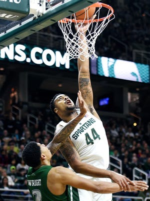 Nick Ward scores over Cleveland State's Anthony Wright during the first half Friday at Breslin Center.