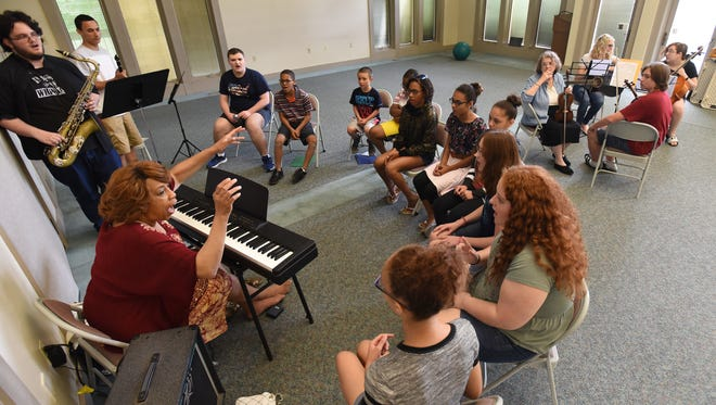 Cassandra McDonald leads her C.A.S.S. Camp during rehersal on Wednesday. The camp finished its 15th year with a musical performance Wednesday evening.