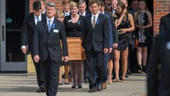 The casket of Otto Warmbier, 22, is carried from Wyoming