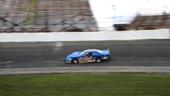 A car takes a practice run at Anderson Speedway in