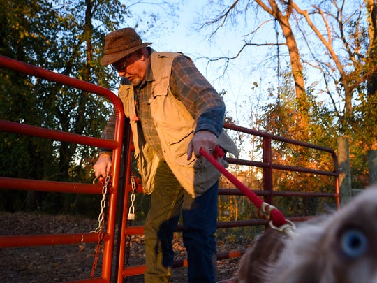 Farmer Steve North opens the gate to land he owns, where degraded streams feeding the Cumberland River could be restored, Monday Nov. 21, 2016, in Nashville, Tenn.