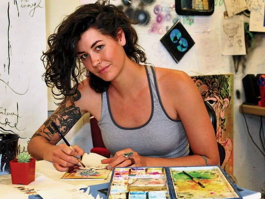 Jaime Guzman for the Sun-News   Cassie Dixon, an artist and graduate student at New Mexico State University, works on a piece  for her upcoming solo show at Art Obscura.