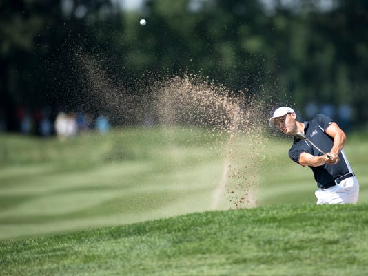 Germany's  Martin Kaymer plays  out of a bunker during the first round of the Golf Europe Tour International Open in Eichenried near Munich, Germany, Thursday, June 22, 2017 .  (Sven Hoppe/dpa via AP)