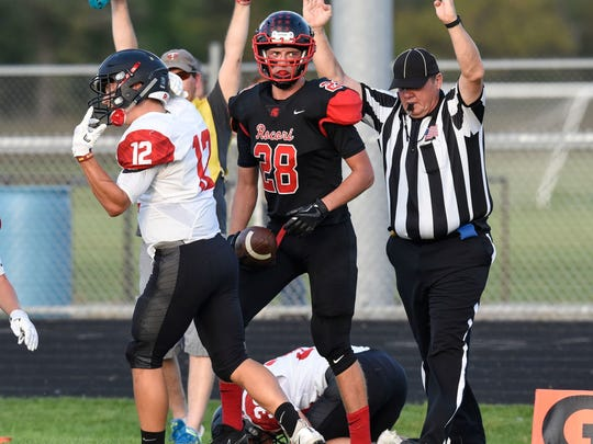 Rocori's Matt Koshiol scores a touchdown during the