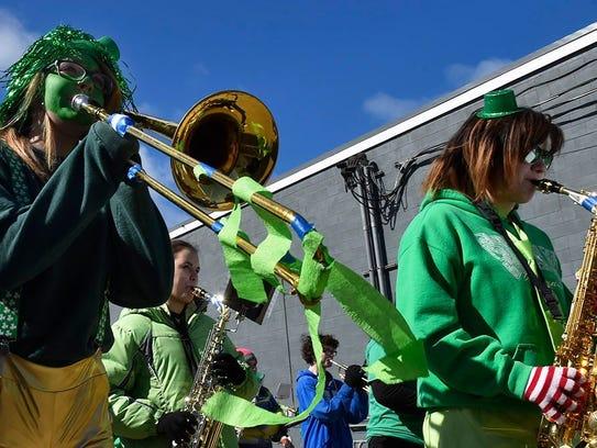 Trombonist Leslie Kivell dressed for the Irish occasion