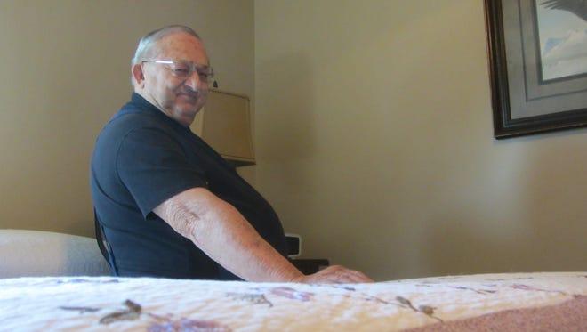 Virgil Pfeifle, 77, sits on the bed at Rocky Mountain Sleep Disorders Center, where he was treated for sleep apnea.