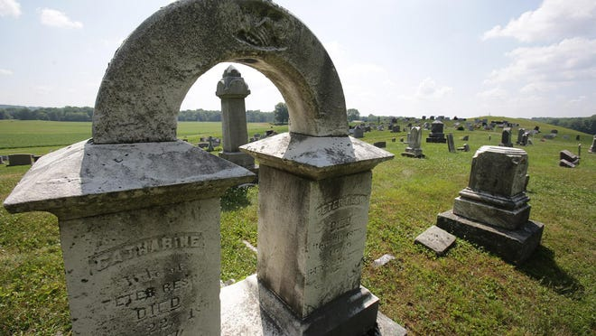 Century-old gravestones are pictured Thursday afternoon at Welty Cemetery on Manchester Avenue SW, just south of Brewster. The village is negotiating with the Welty Cemetery Association on a proposal to take over the site.