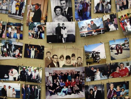 Family members display photos at the memorial service for Crecencio Padilla.