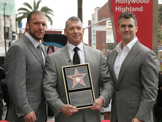 Wrestling superstar Triple H, left, WWE Chairman Vince