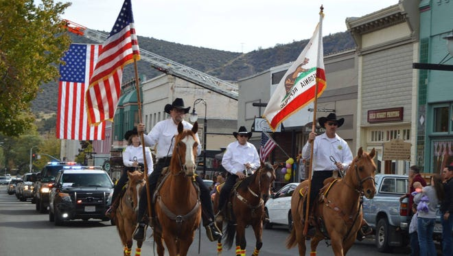 The Siskiyou County Sheriff's Posse leads a funeral procession in Yreka for a fallen sheriff's deputy.