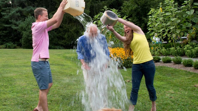 Delaware Gov. Jack Markell is doused with ice water by his children Molly, 21, and Michael, 19, as part of the ALS Ice Bucket Challenge.